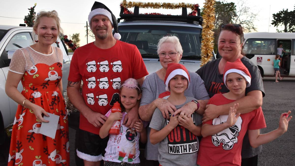 Winner: Organiser Megan Crowther presents the Summer family with best dressed vehicle at the Mount Isa Christmas Lights Cavalcade in 2018. Photo:file