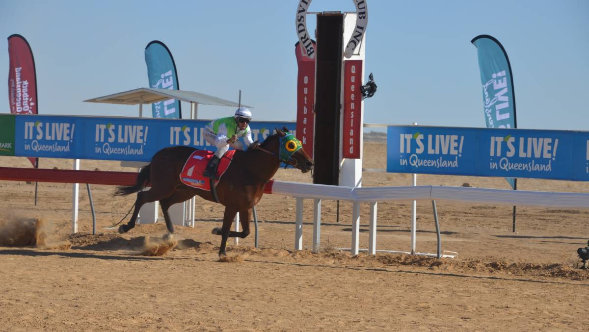 FASTER FELLOW: Roma trainer Craig Smith took out last year's Birdsville Cup on the Adrian Coome-ridden Fast Fella. Photo: Derek Barry